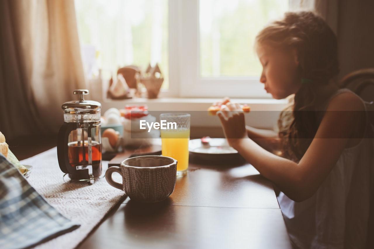 Girl Having Breakfast At Home
