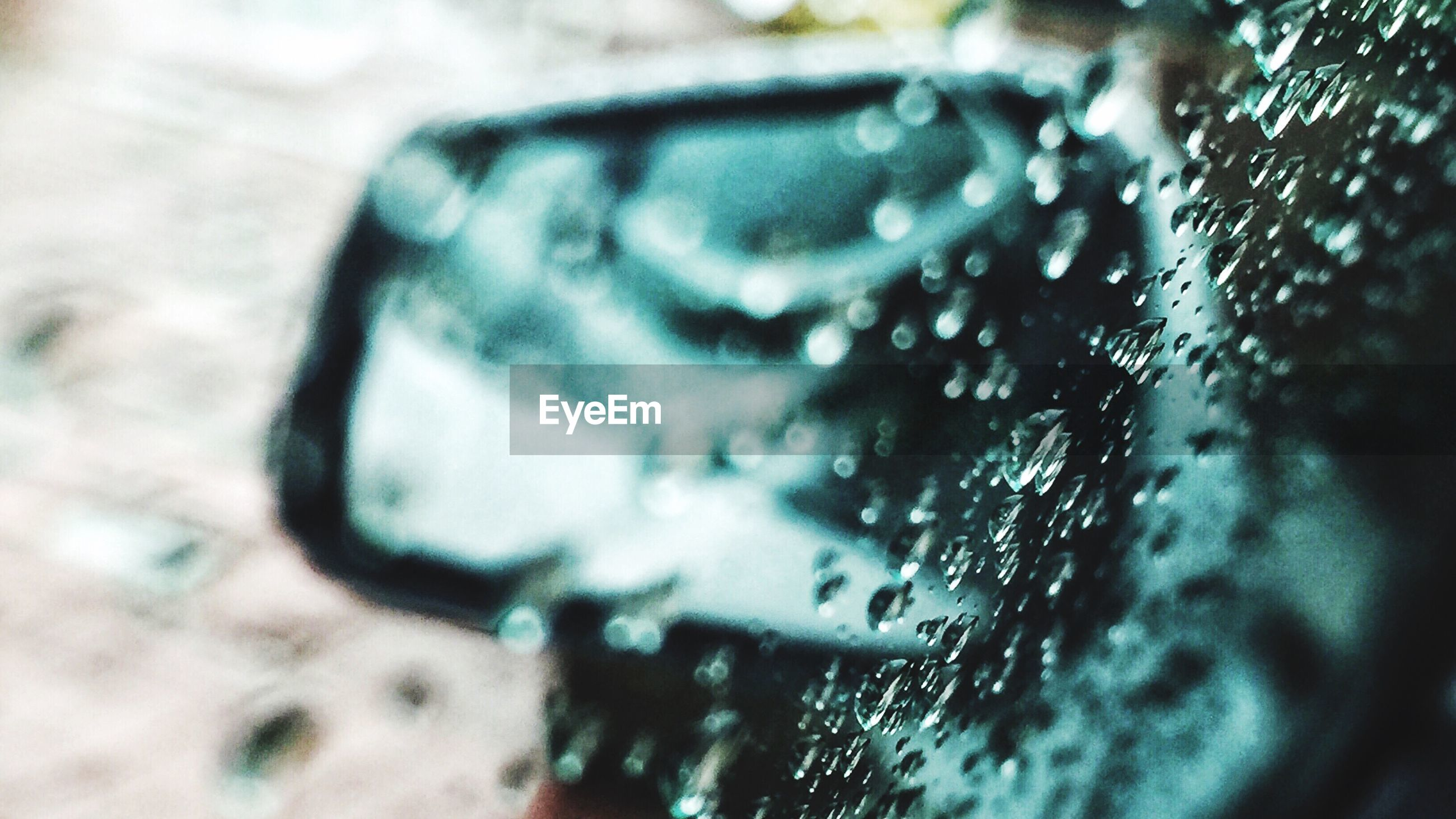 close-up, land vehicle, wet, indoors, transportation, street, selective focus, mode of transport, glass - material, focus on foreground, drop, reflection, car, high angle view, rain, transparent, day, water, no people, window