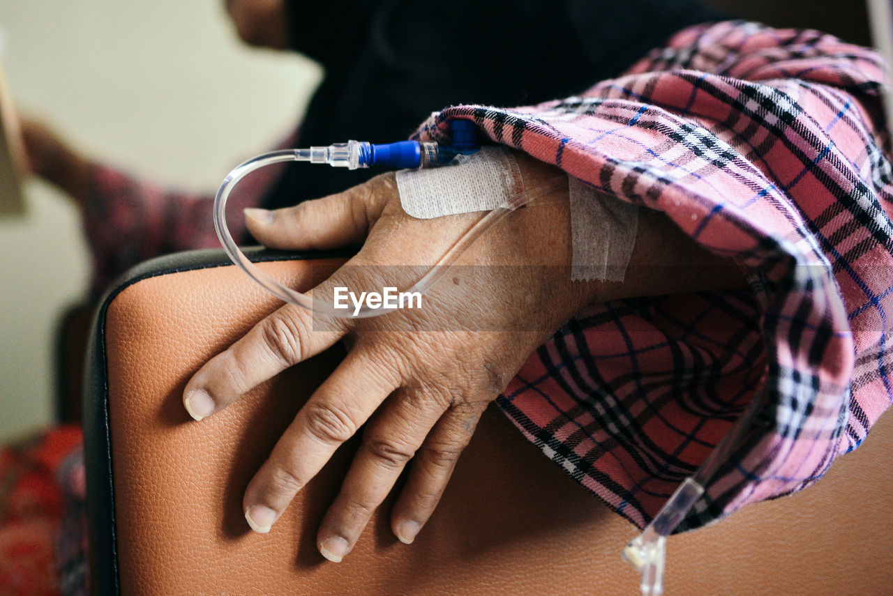 Close-Up Of Patient Hand With Iv Drip