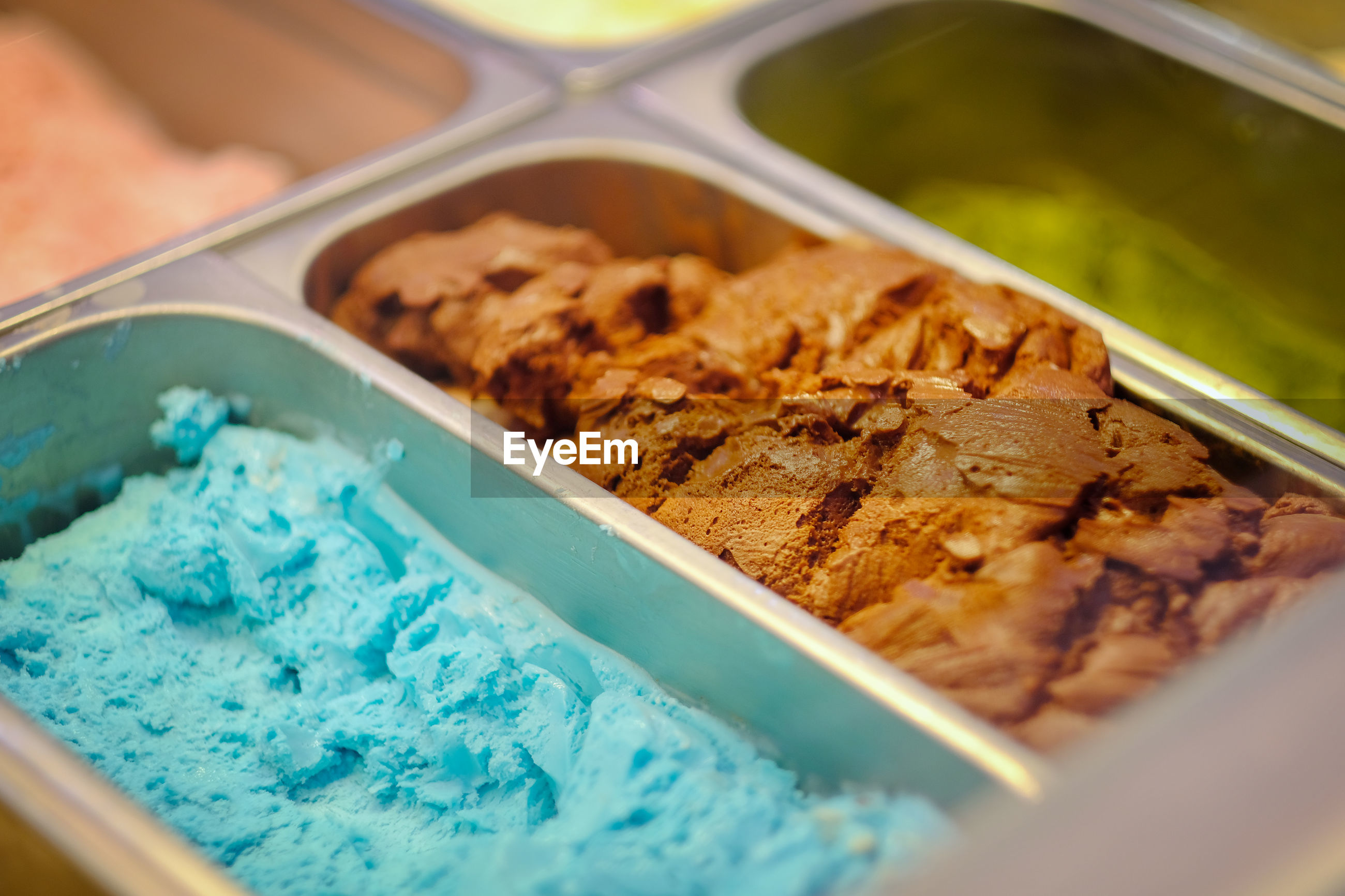 High angle view of ice cream in containers