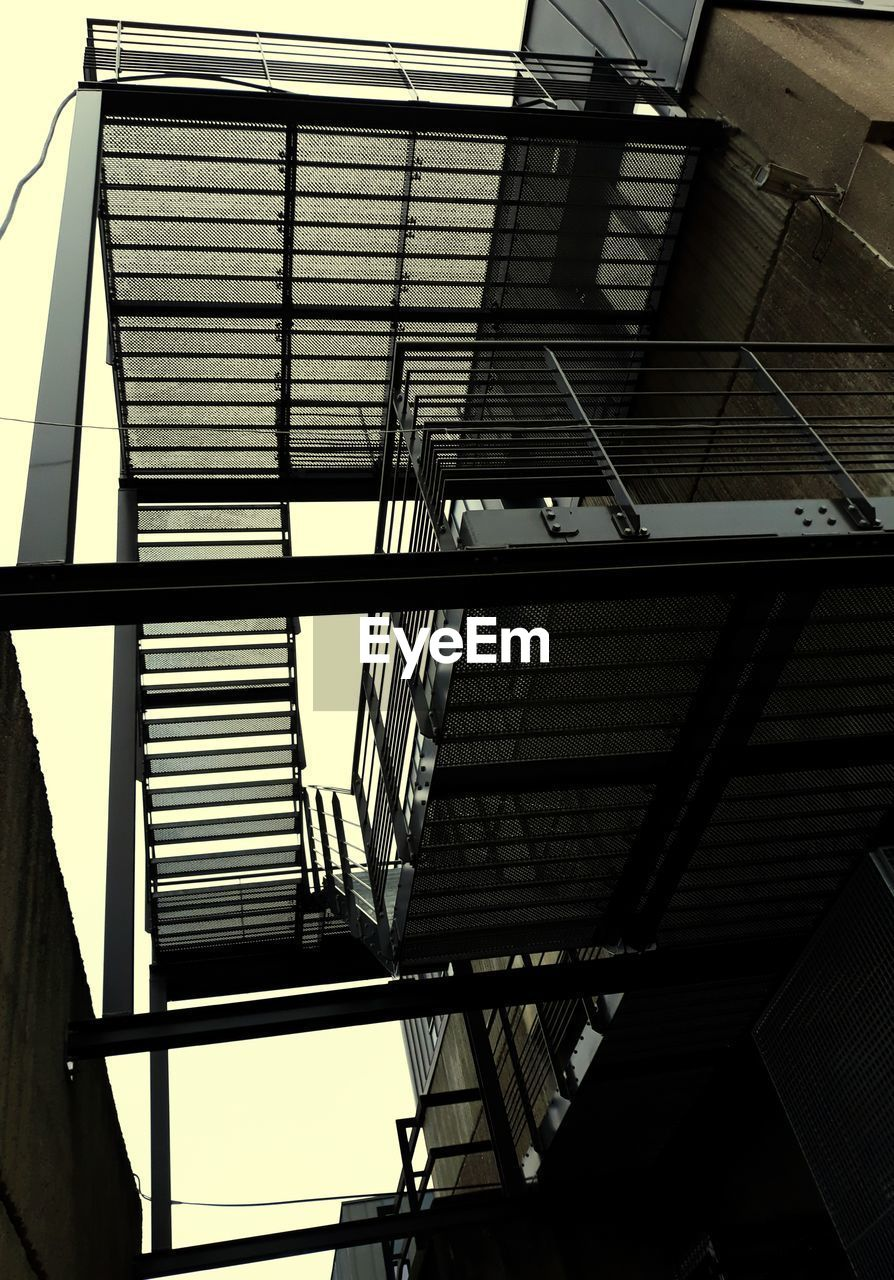 low angle view, architecture, built structure, building exterior, staircase, no people, window, fire escape, day, indoors