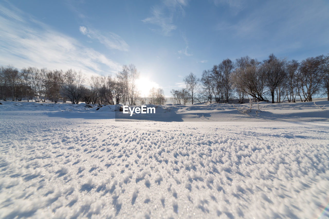 SNOW COVERED FIELD AGAINST SKY DURING WINTER