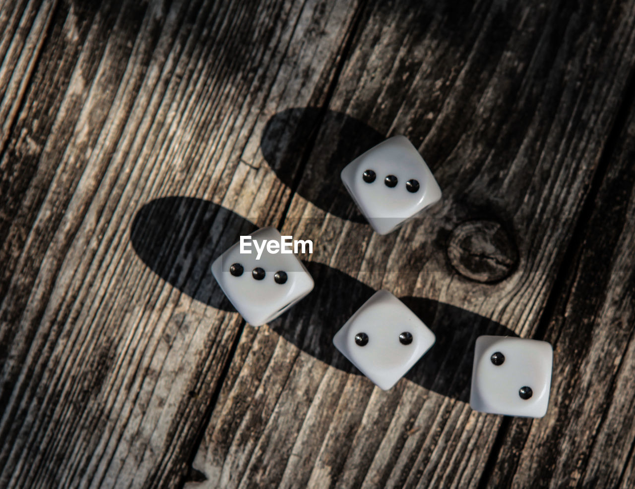 wood - material, dice, still life, high angle view, indoors, table, no people, close-up, arts culture and entertainment, leisure games, relaxation, luck, shape, opportunity, pattern, directly above, leisure activity, gambling, cube shape, spotted