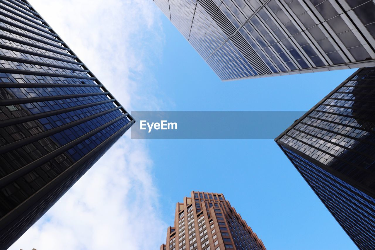 architecture, low angle view, building exterior, built structure, skyscraper, sky, day, city, modern, outdoors, no people, tall, blue