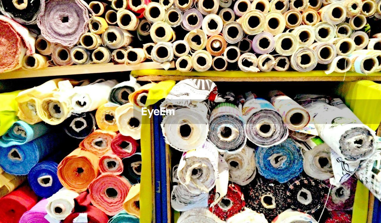 Detail Shot Of Colorful Rolls Of Fabric