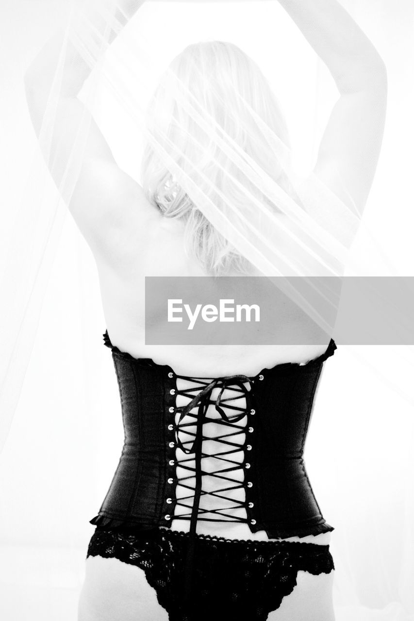 Rear View Of A Woman Wearing Corset