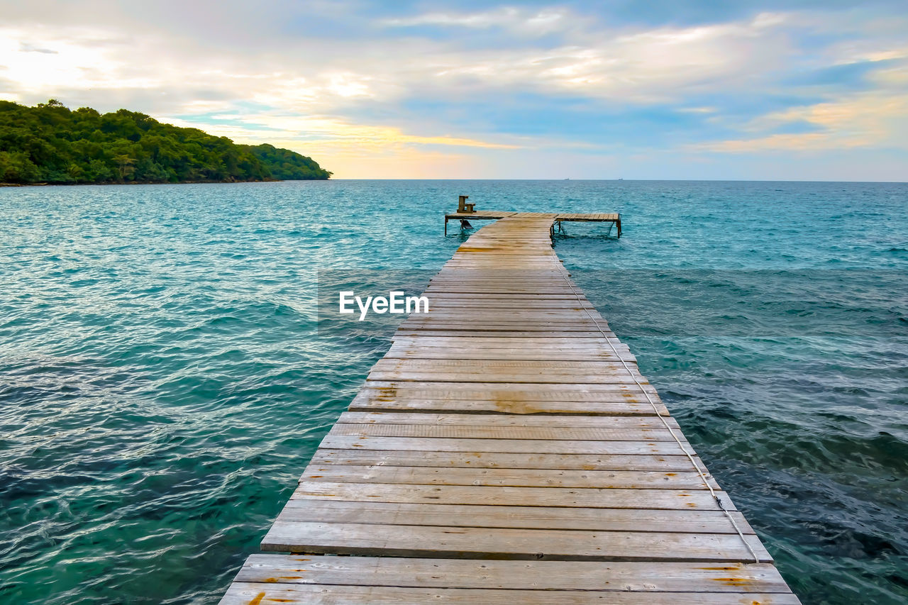 water, sky, sea, beauty in nature, scenics - nature, horizon, pier, horizon over water, cloud - sky, wood - material, the way forward, tranquility, direction, idyllic, tranquil scene, jetty, nature, non-urban scene, day, no people, outdoors, wood paneling, long, turquoise colored