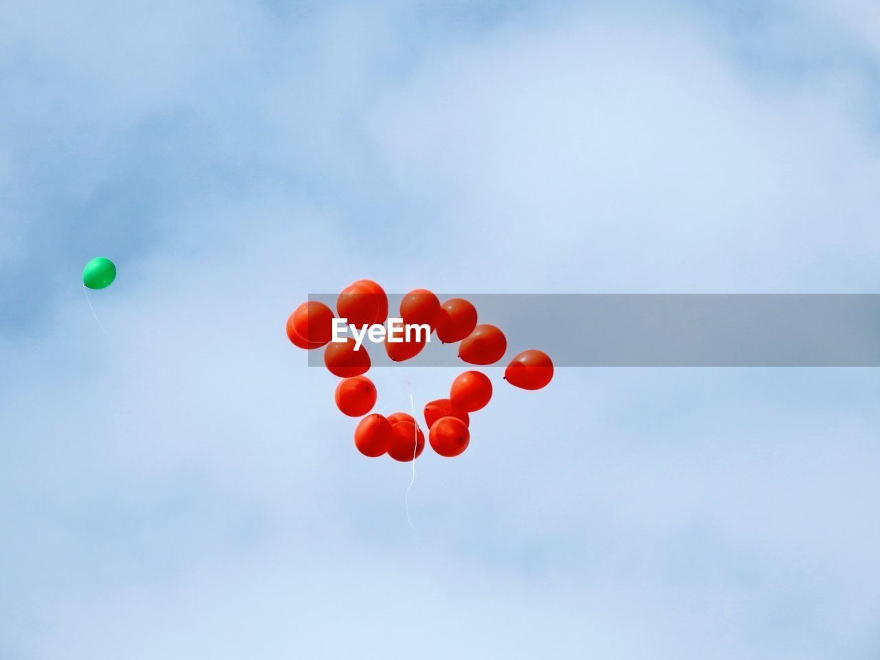balloon, red, low angle view, sky, cloud - sky, helium balloon, day, nature, no people, mid-air, celebration, multi colored, flying, outdoors, positive emotion, heart shape, love, emotion, group of objects, large group of objects, helium