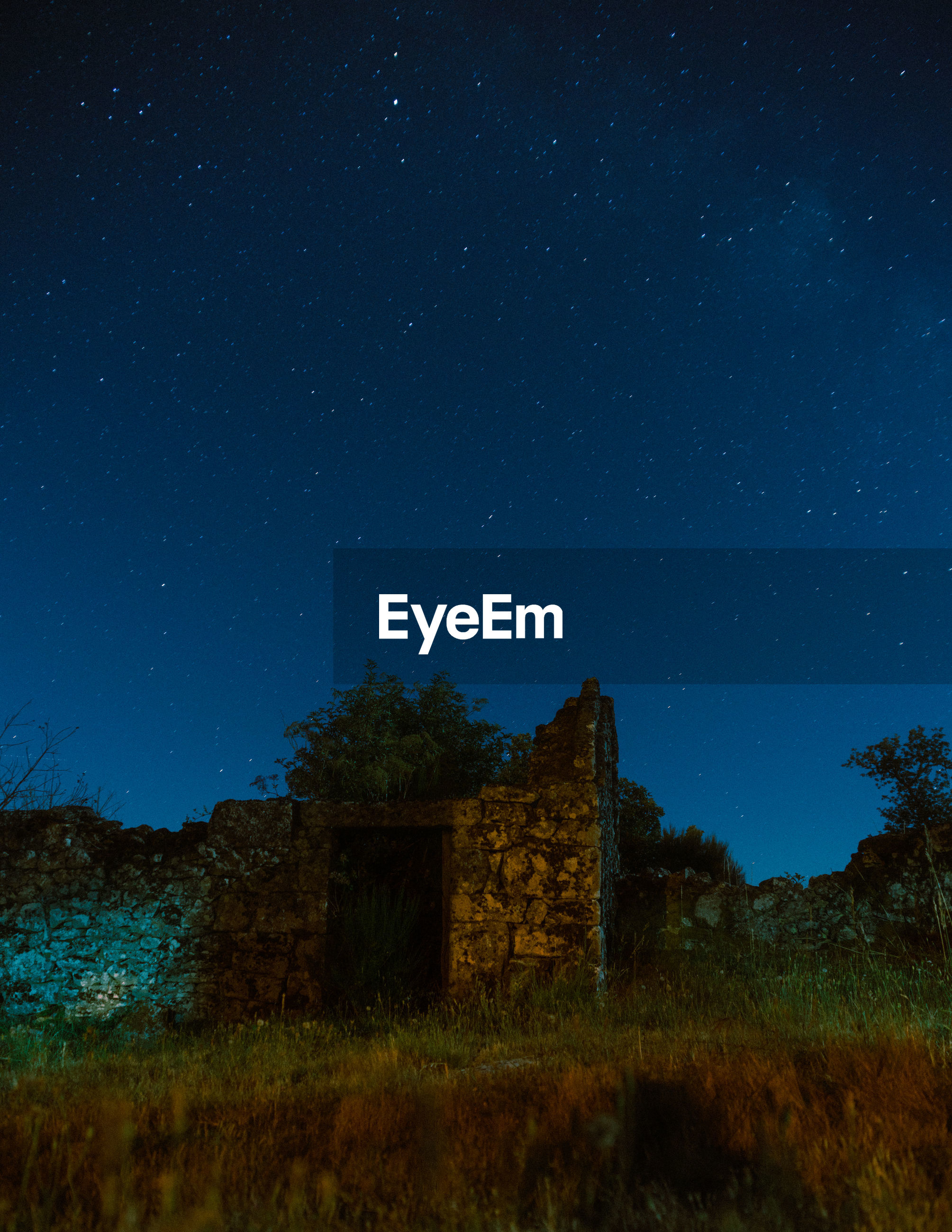 ABANDONED BUILDING AGAINST CLEAR SKY AT NIGHT DURING RAINY SEASON