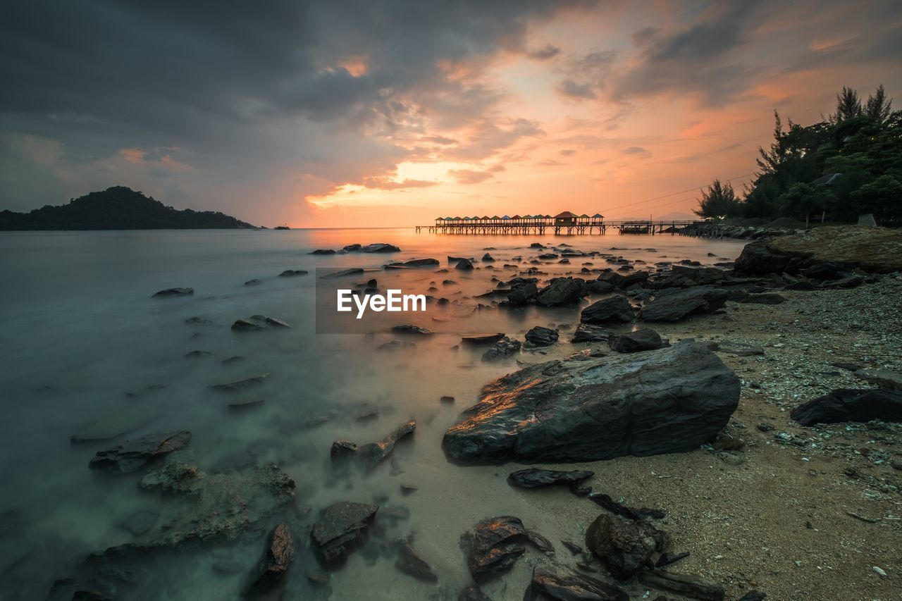 water, sky, sunset, cloud - sky, sea, scenics - nature, beauty in nature, rock, tranquility, beach, tranquil scene, nature, land, rock - object, solid, orange color, no people, idyllic, non-urban scene, outdoors, bay