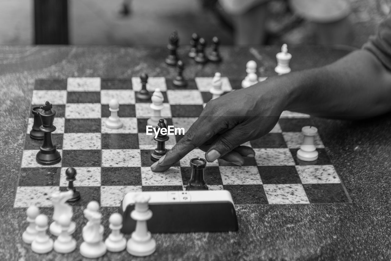 Cropped Hand Playing Chess