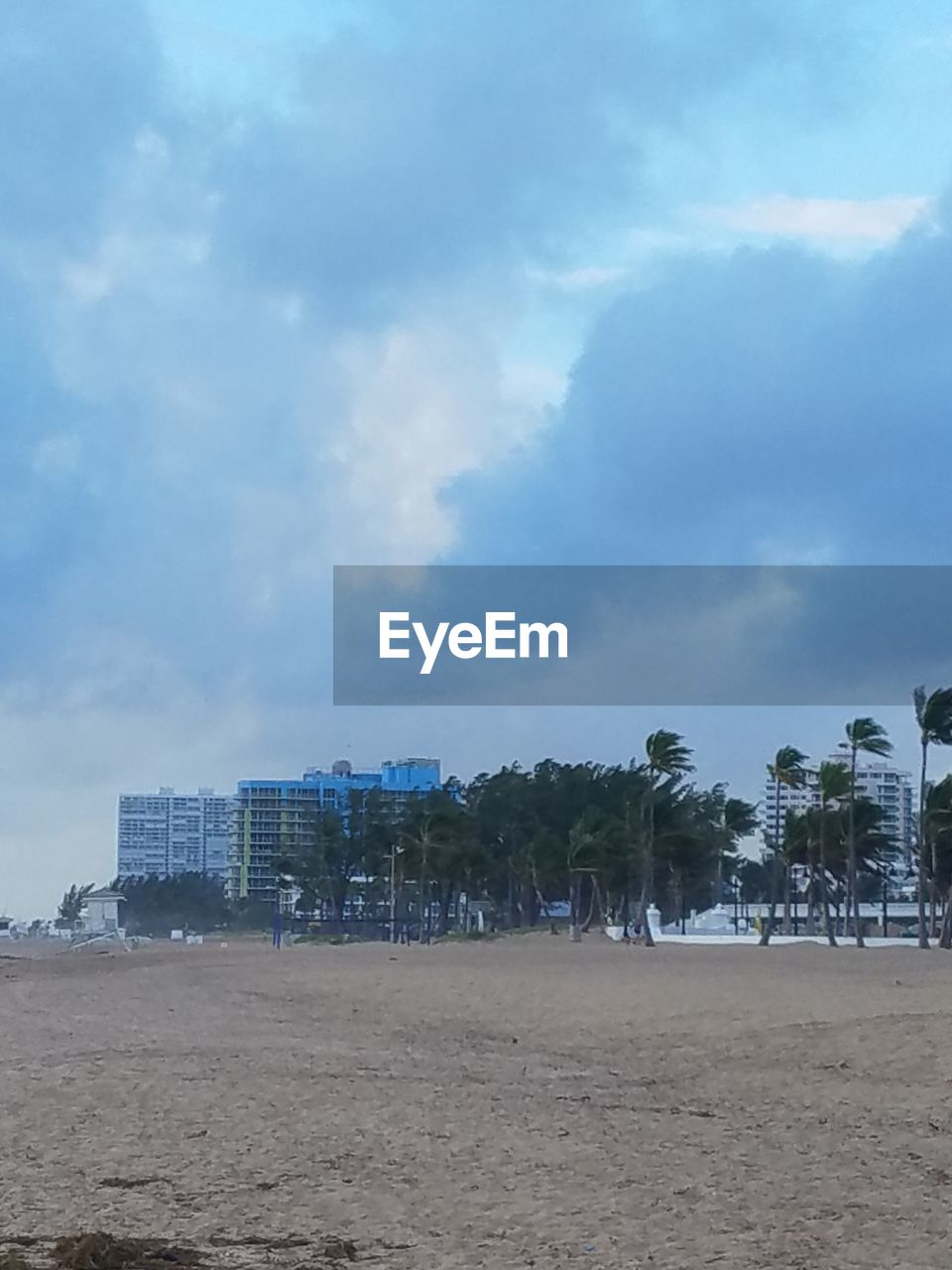 sky, sand, architecture, cloud - sky, built structure, beach, building exterior, day, outdoors, tree, nature, no people, city, palm tree, modern, beauty in nature