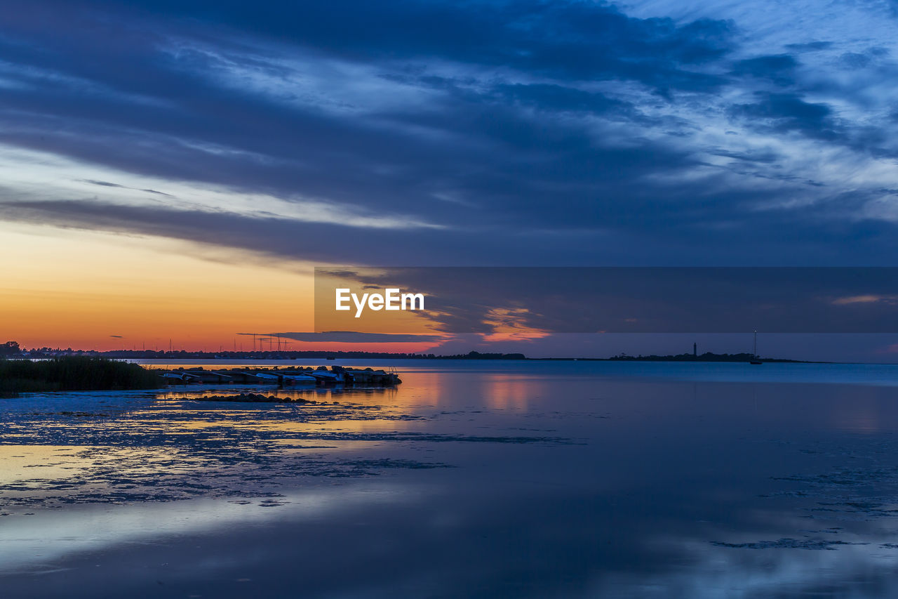 sky, water, cloud - sky, sunset, sea, beauty in nature, scenics - nature, tranquility, beach, tranquil scene, nature, land, no people, idyllic, reflection, outdoors, waterfront, orange color, dusk