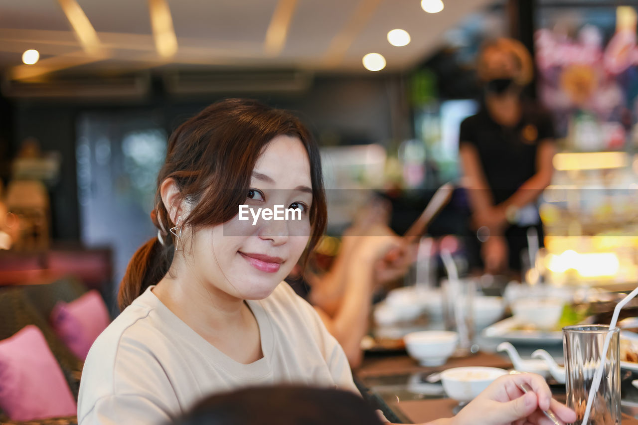 Portrait of woman in restaurant