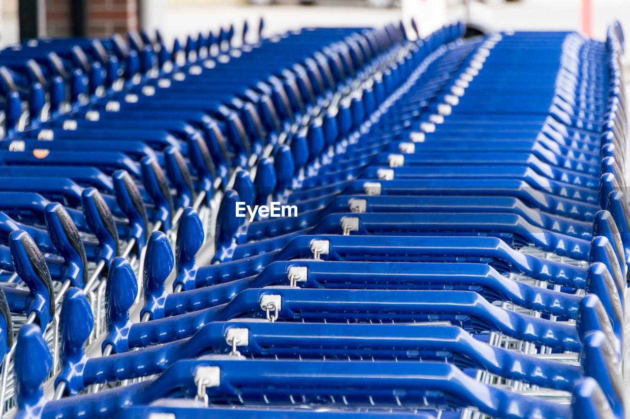 Close-Up Of Shopping Carts Arranged At Supermarket