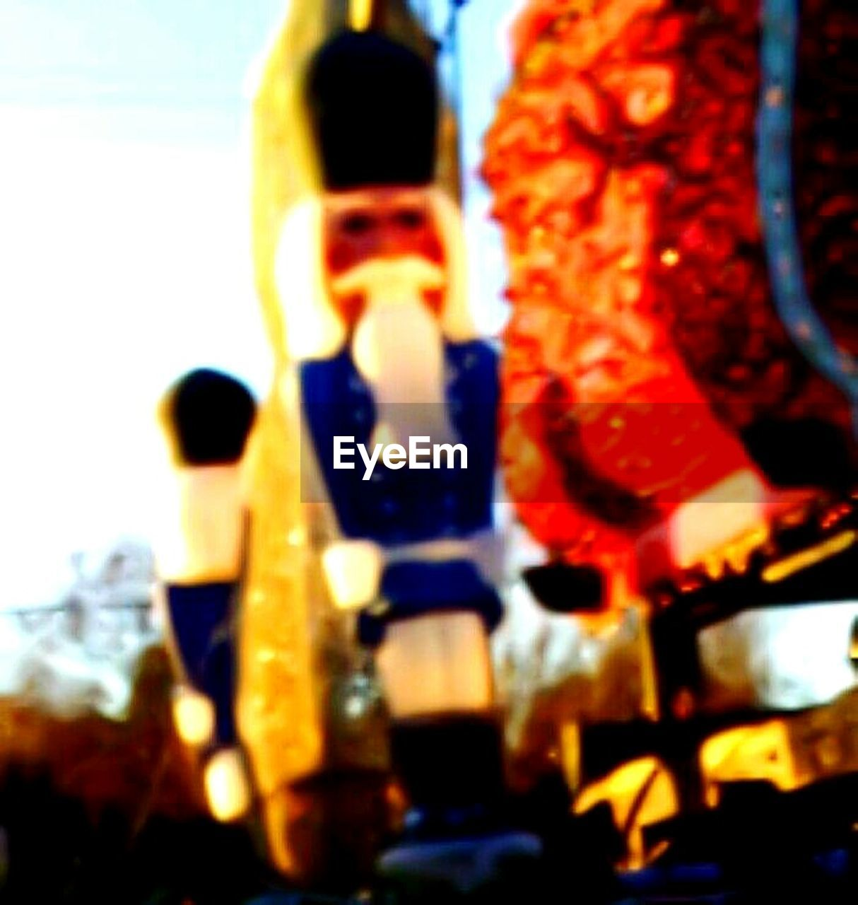 human representation, statue, no people, sculpture, outdoors, low angle view, close-up, day, sky, carousel
