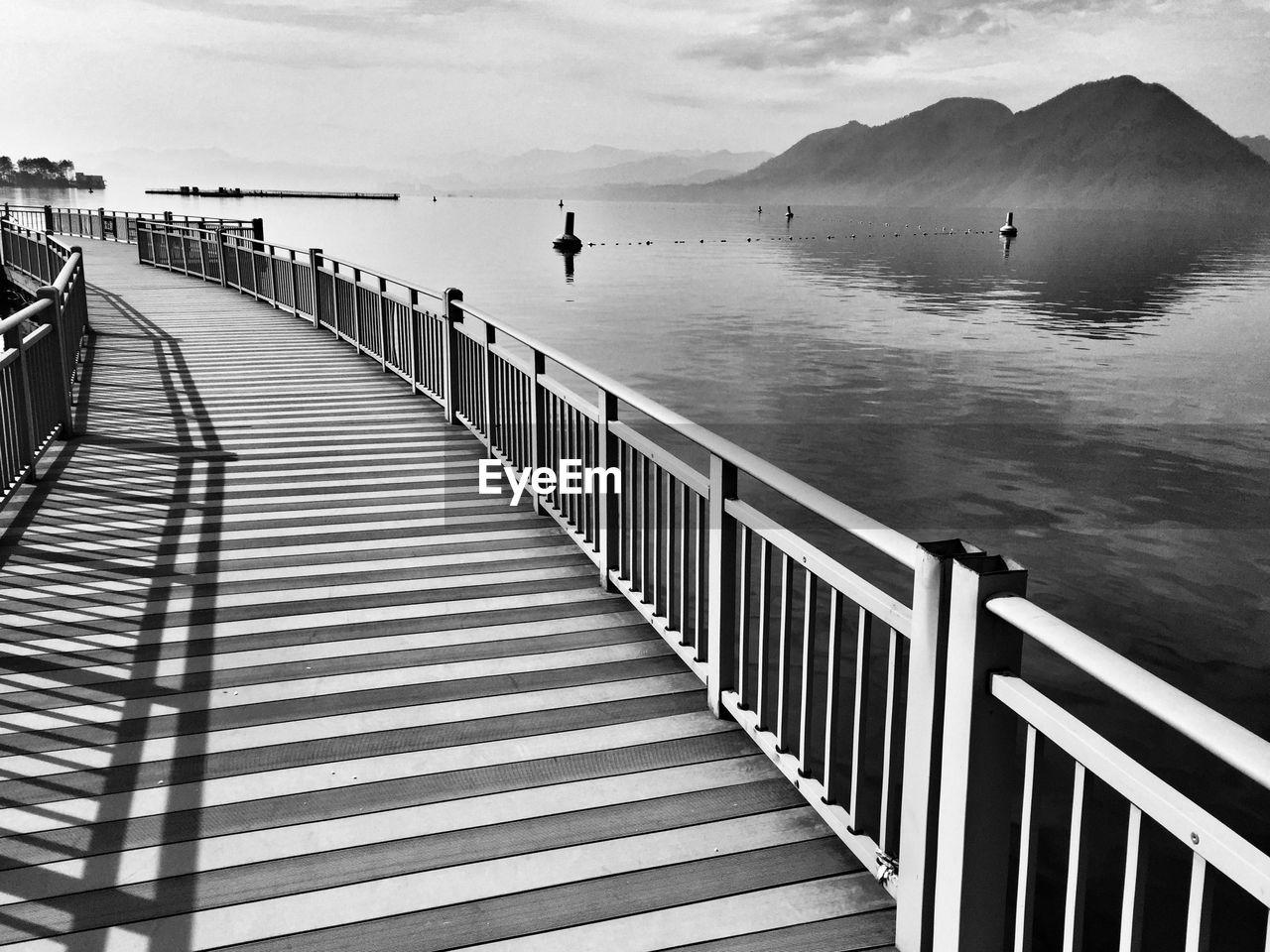 Boardwalk By River Against Sky