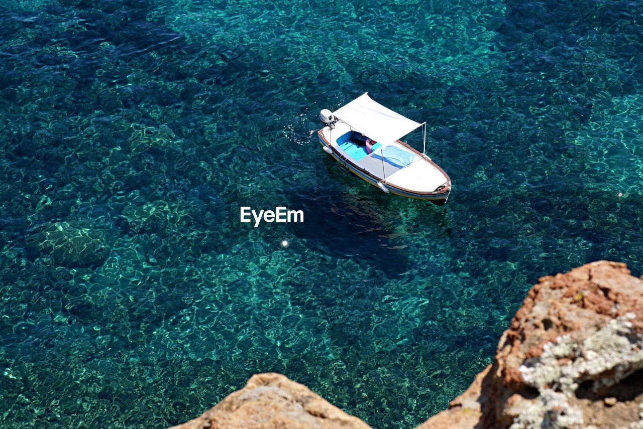 High angle view of motorboat moored in sea at aeolian islands