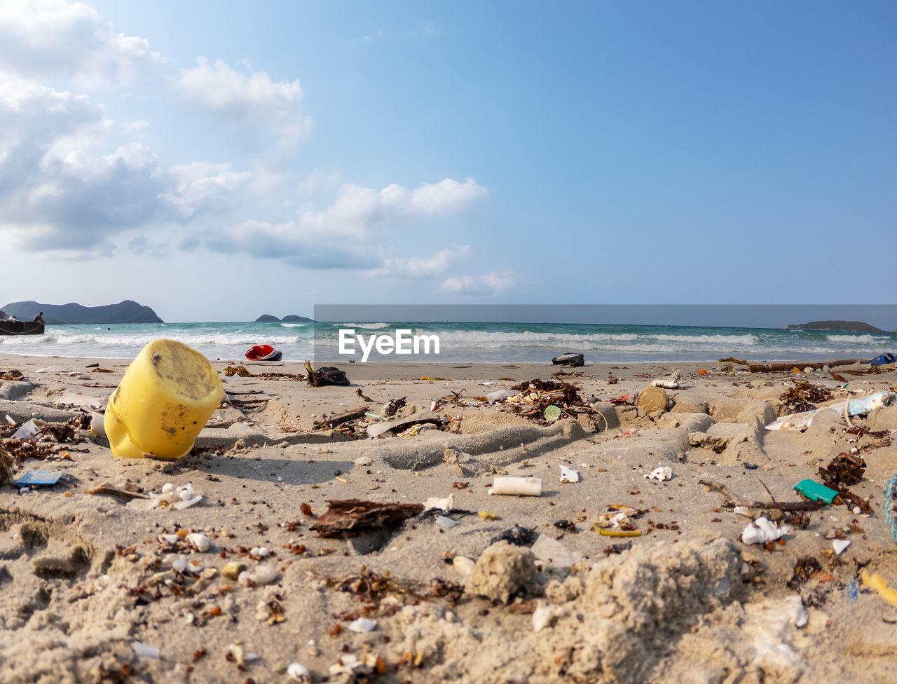 Garbage at beach against sky