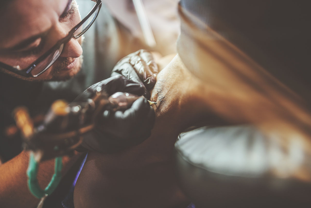 Man Tattooing Customer
