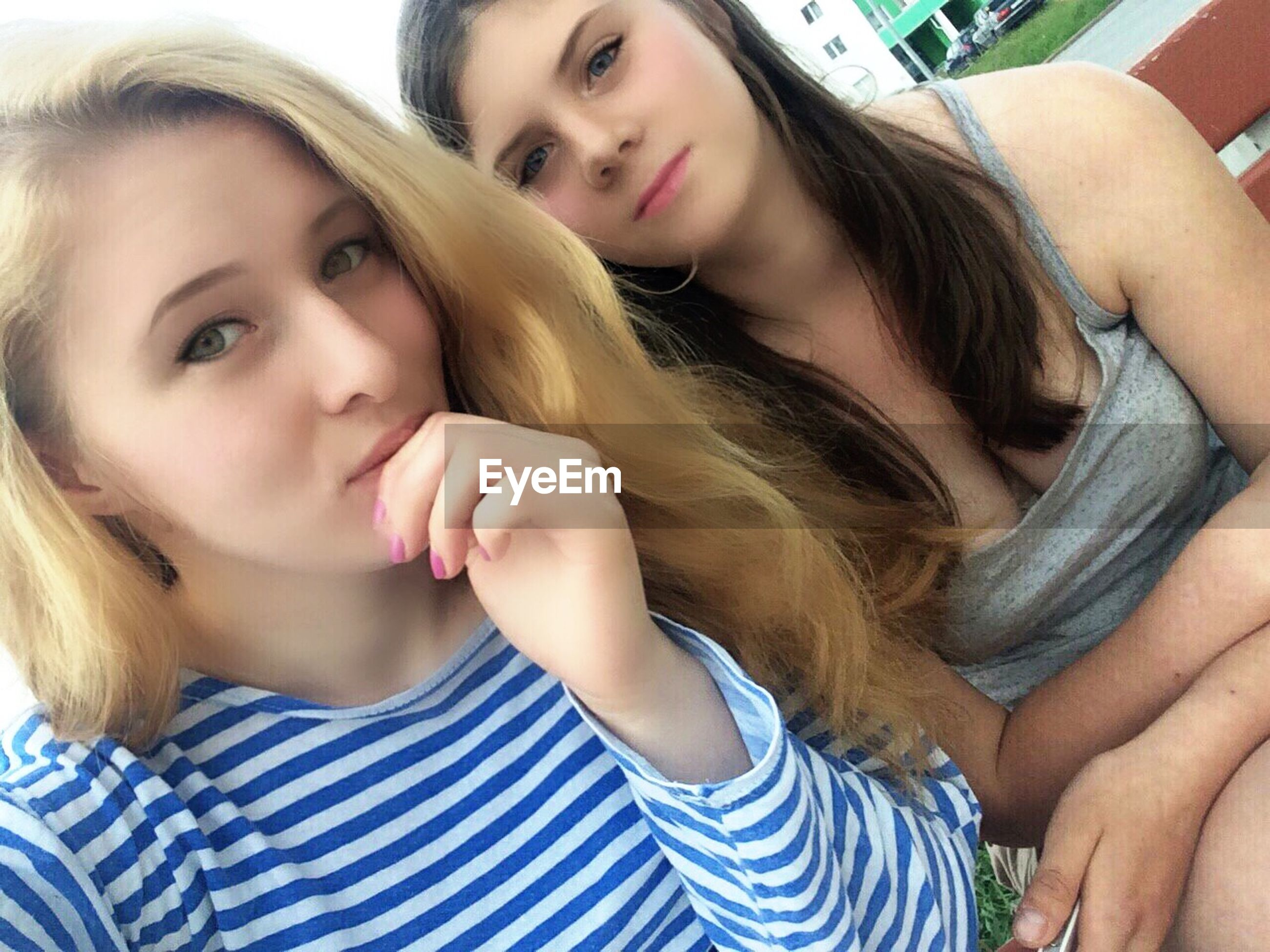 two people, real people, casual clothing, young adult, childhood, front view, girls, long hair, young women, lifestyles, togetherness, bonding, looking at camera, day, indoors, close-up, friendship, people