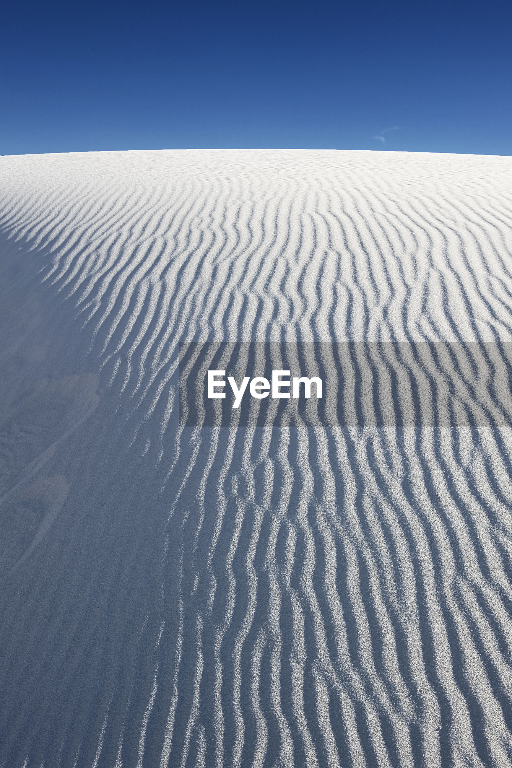 High angle view of sand dunes at white sands national monument against clear sky
