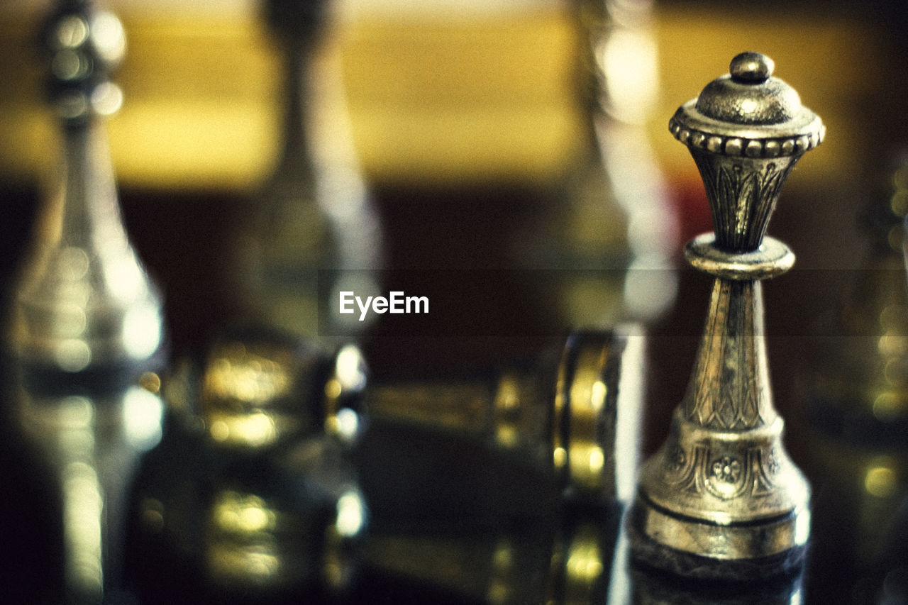 focus on foreground, bottle, indoors, close-up, no people, chess, chess piece, day, queen - chess piece