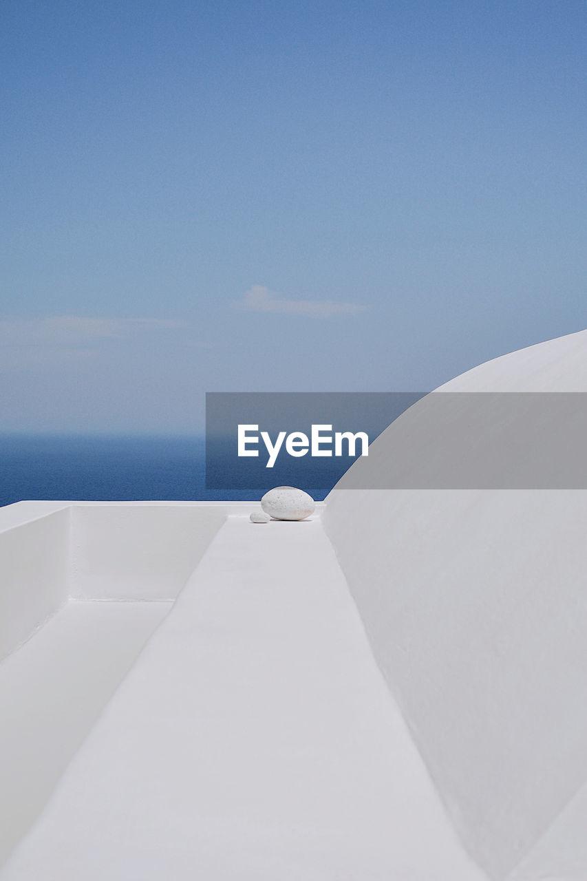 White boat on sea against blue sky