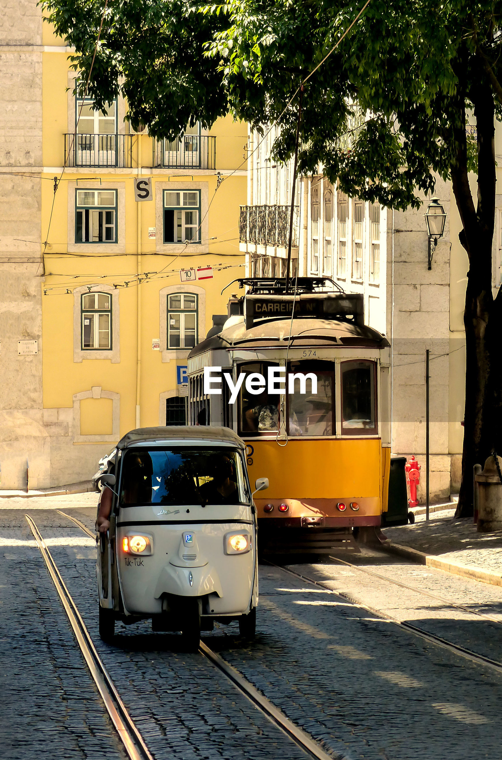 Car and tram on road