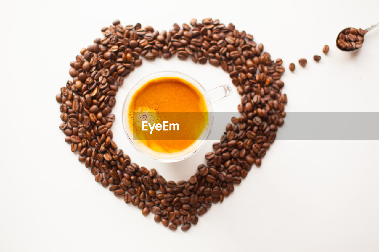 food and drink, indoors, white background, freshness, directly above, studio shot, food, drink, brown, still life, wellbeing, refreshment, healthy eating, coffee, close-up, coffee - drink, no people, high angle view, cup, roasted coffee bean, egg yolk