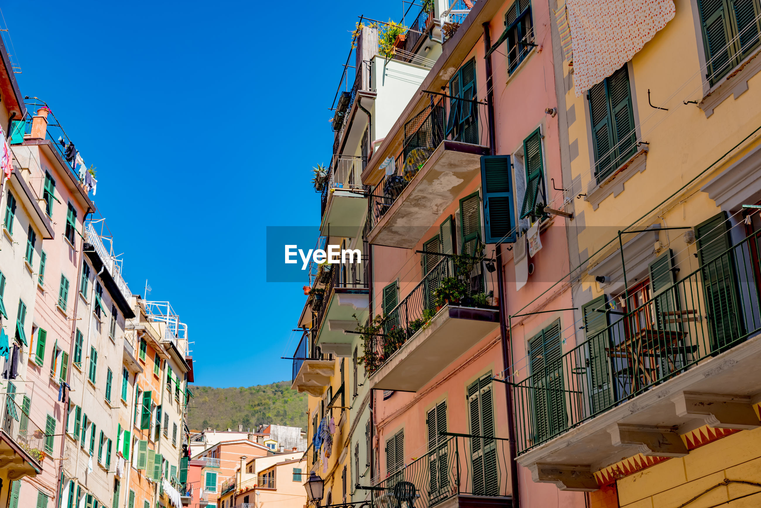 Low angle view of buildings against clear sky at riomaggiore