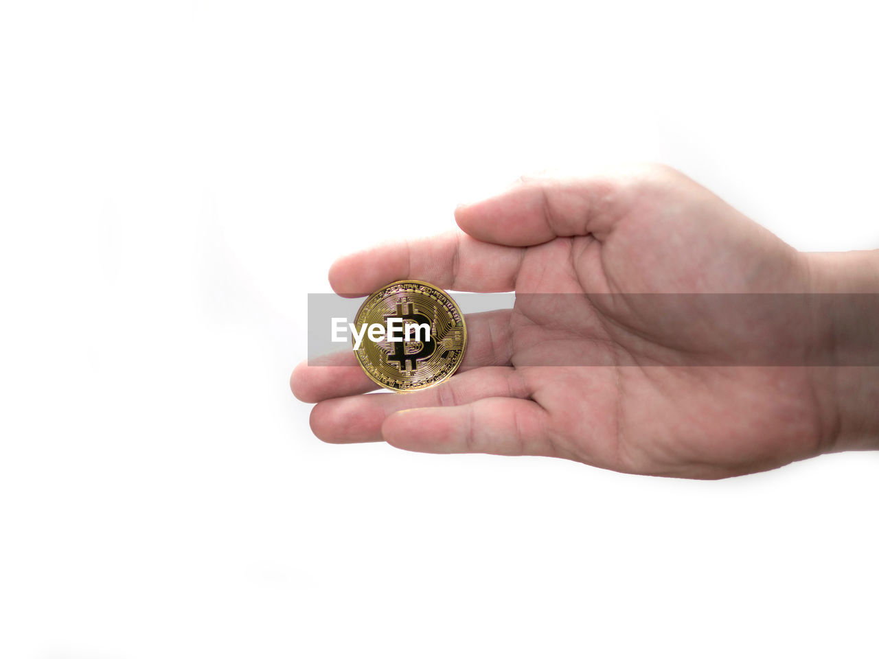 Close-up of hand holding bitcoin over white background