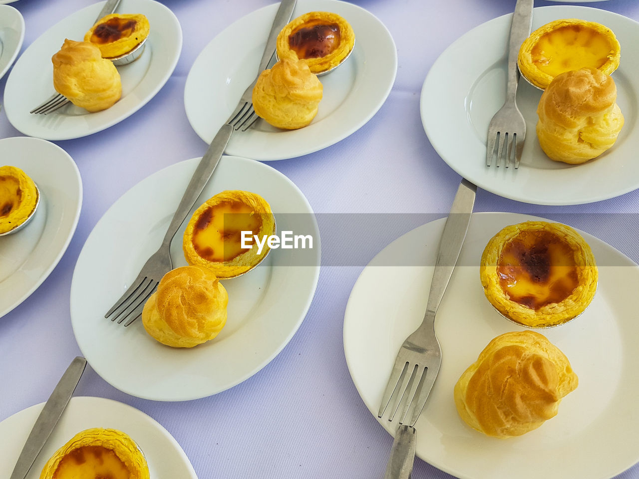 food and drink, plate, food, ready-to-eat, freshness, table, still life, high angle view, indoors, no people, egg, serving size, indulgence, directly above, breakfast, meal, yellow, baked, close-up, sweet food, temptation, snack