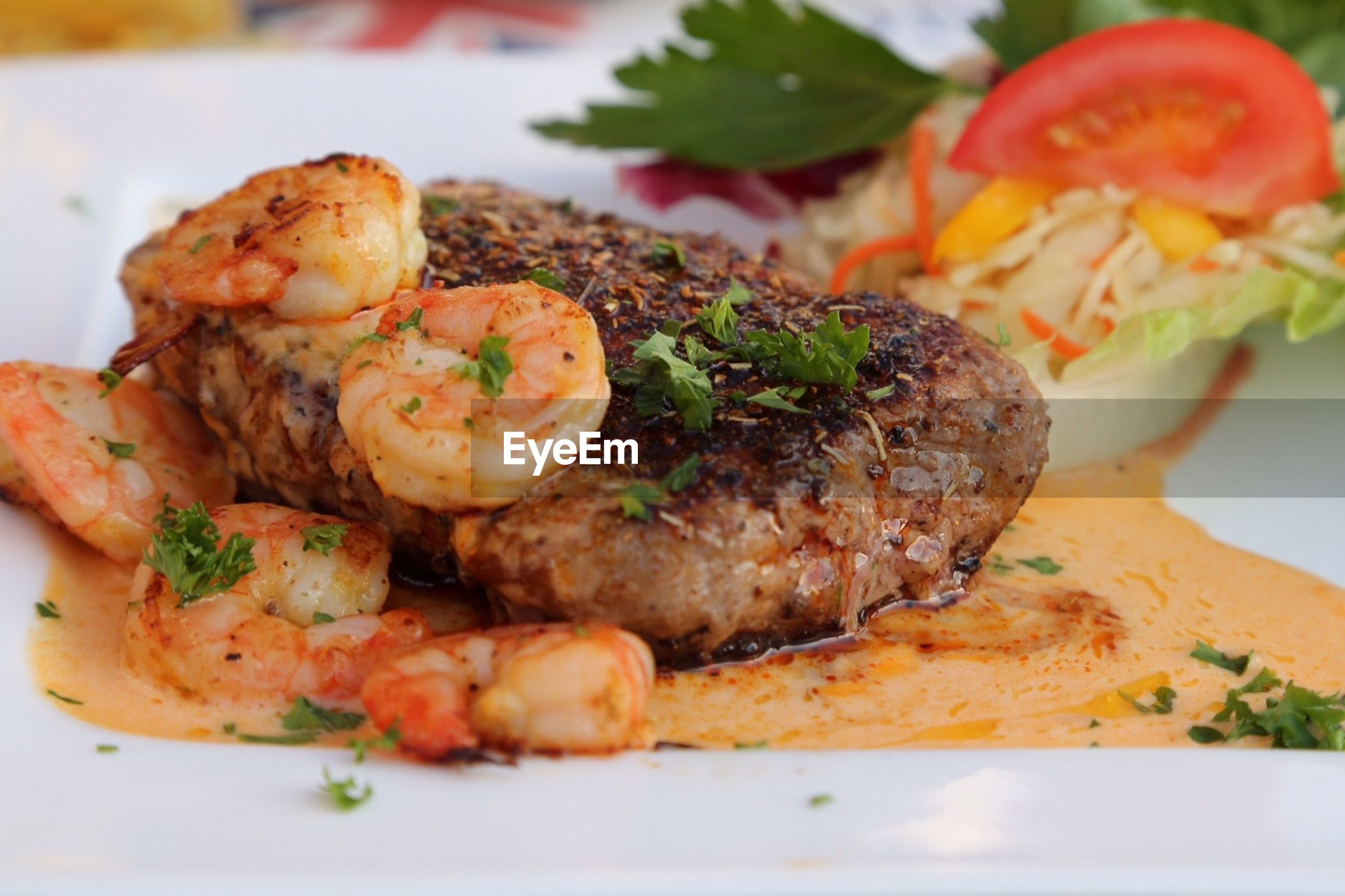 Close-up of served seafood with beef in plate