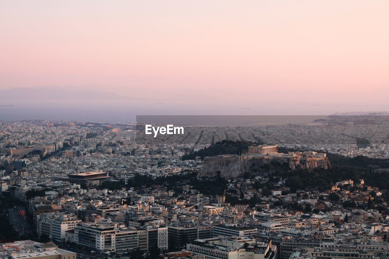 Aerial View Of Cityscape Against Sky During Sunrise