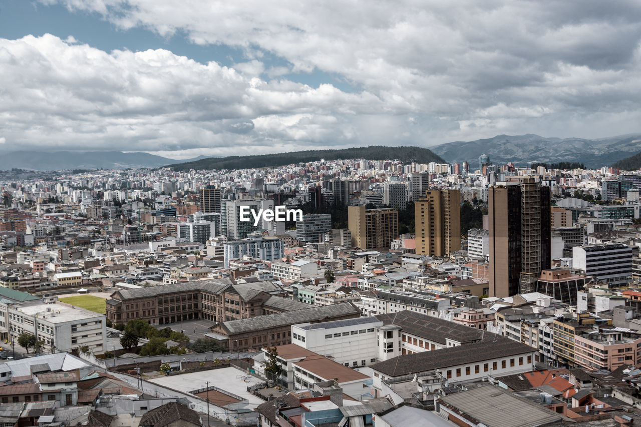 building exterior, architecture, built structure, cloud - sky, city, cityscape, sky, building, crowd, residential district, crowded, nature, high angle view, office building exterior, day, skyscraper, outdoors, tower, city life, settlement, financial district
