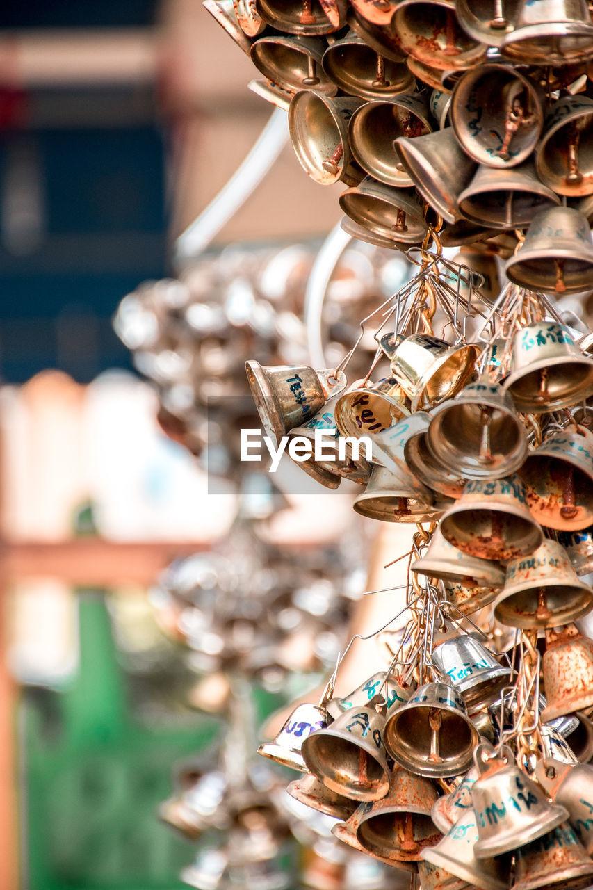 Close-Up Of Bells Hanging For Sale At Market