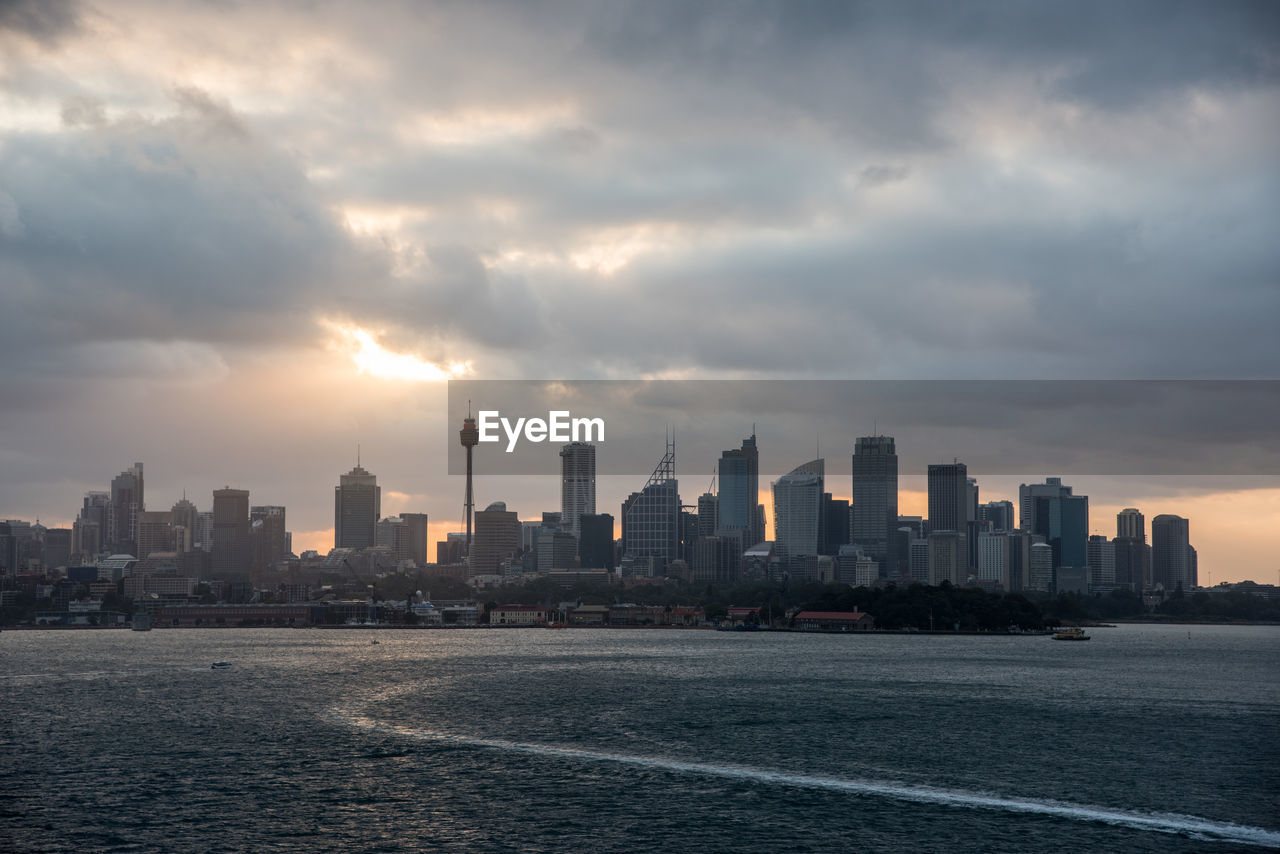 sky, building exterior, built structure, cloud - sky, architecture, city, building, cityscape, urban skyline, sunset, office building exterior, skyscraper, nature, landscape, water, waterfront, outdoors, no people, sea, tall - high, financial district
