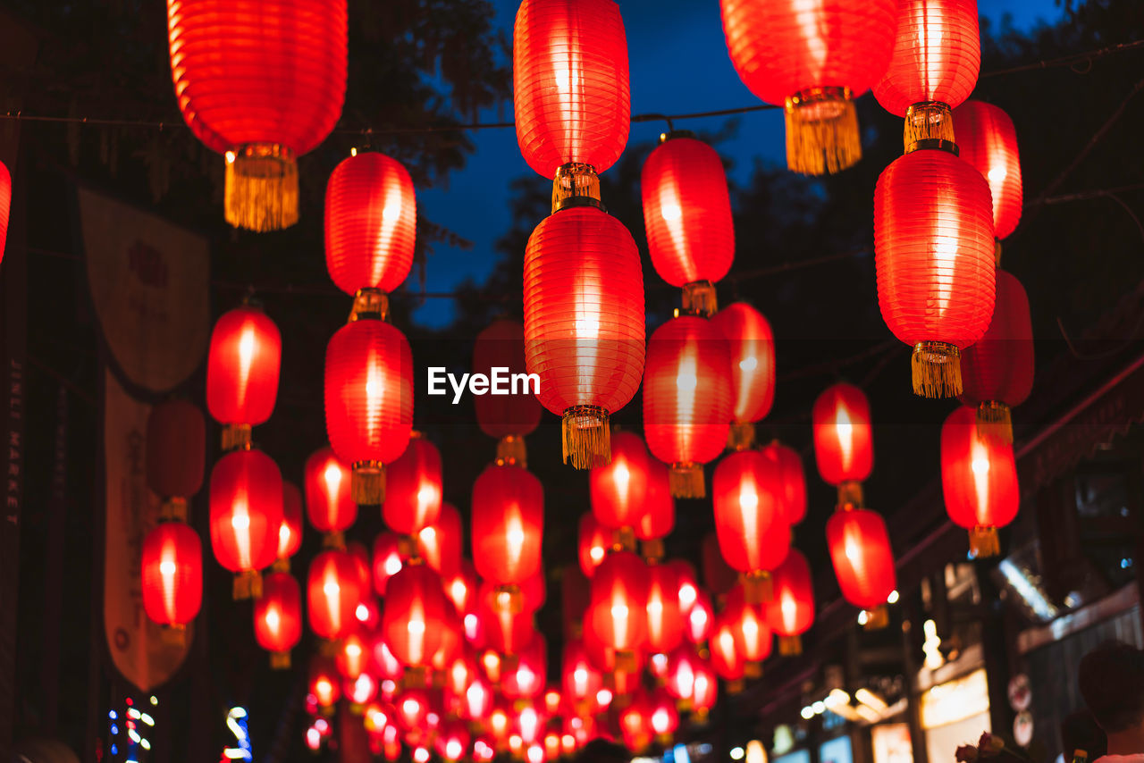 lighting equipment, illuminated, hanging, chinese lantern, decoration, lantern, red, night, celebration, chinese lantern festival, low angle view, no people, repetition, traditional festival, large group of objects, festival, chinese new year, outdoors, electric lamp