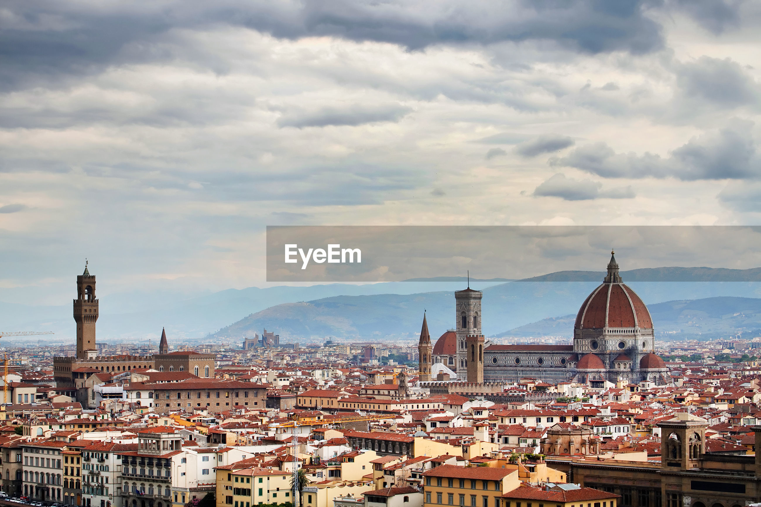 Panoramic florence cityscape against cloudy sky