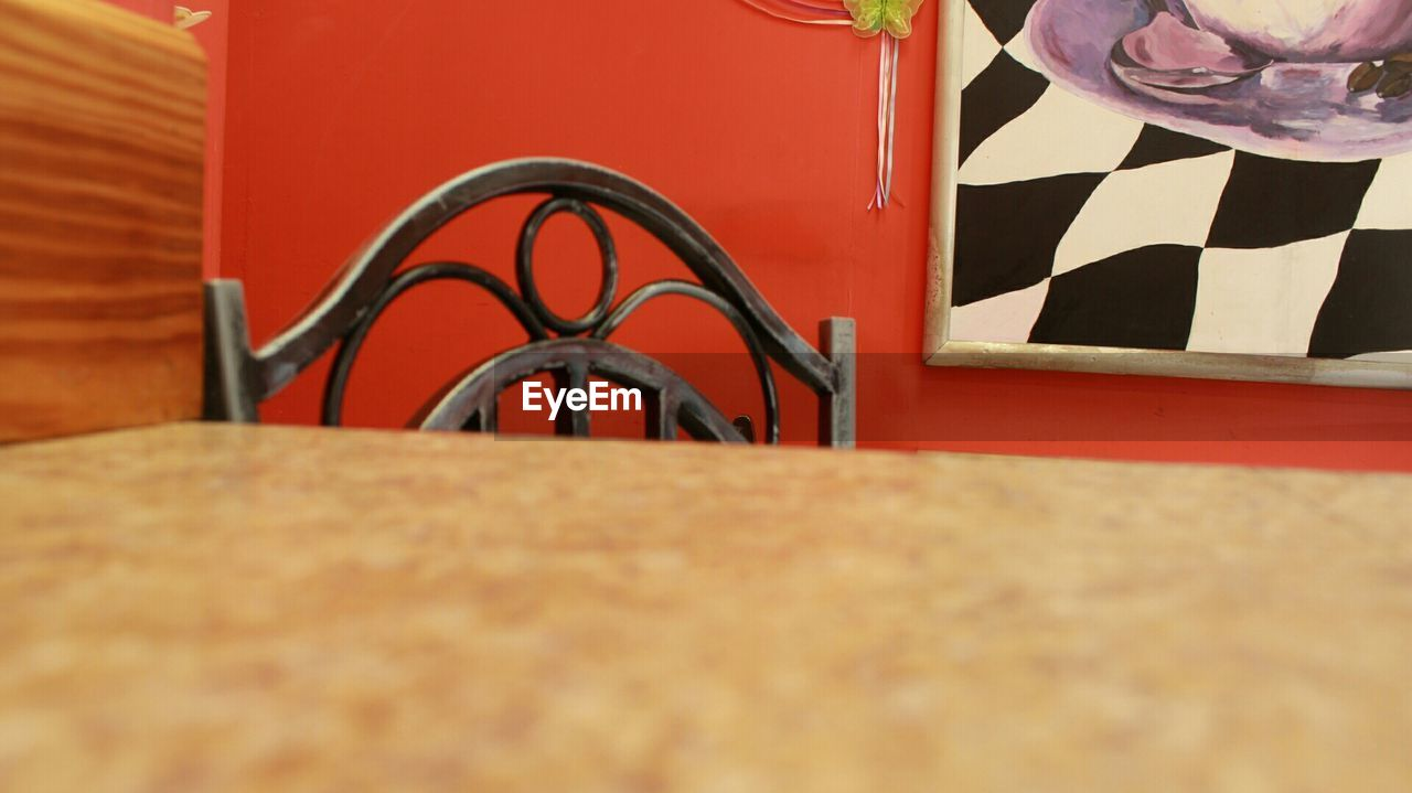 Close-up of chair across the table