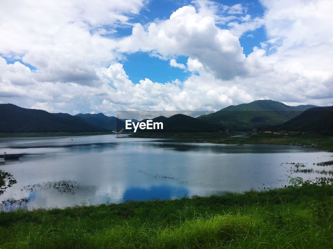 mountain, sky, water, beauty in nature, nature, scenics, tranquility, lake, landscape, grass, cloud - sky, tranquil scene, outdoors, day, no people, scenery