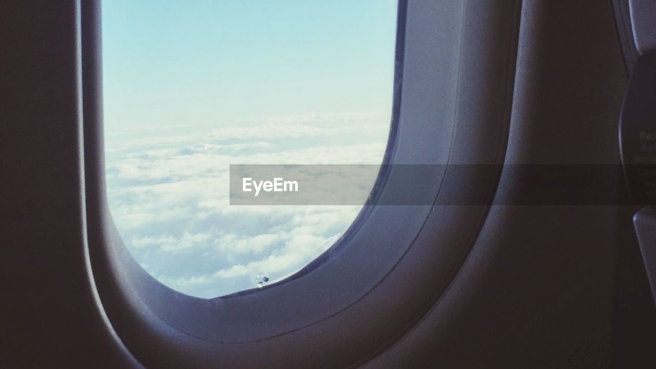 window, airplane, vehicle interior, journey, air vehicle, transportation, no people, sky, travel, day, mode of transport, scenics, landscape, aerial view, tranquil scene, nature, flying, cloud - sky, tranquility, indoors, close-up, beauty in nature, mid-air, airplane wing