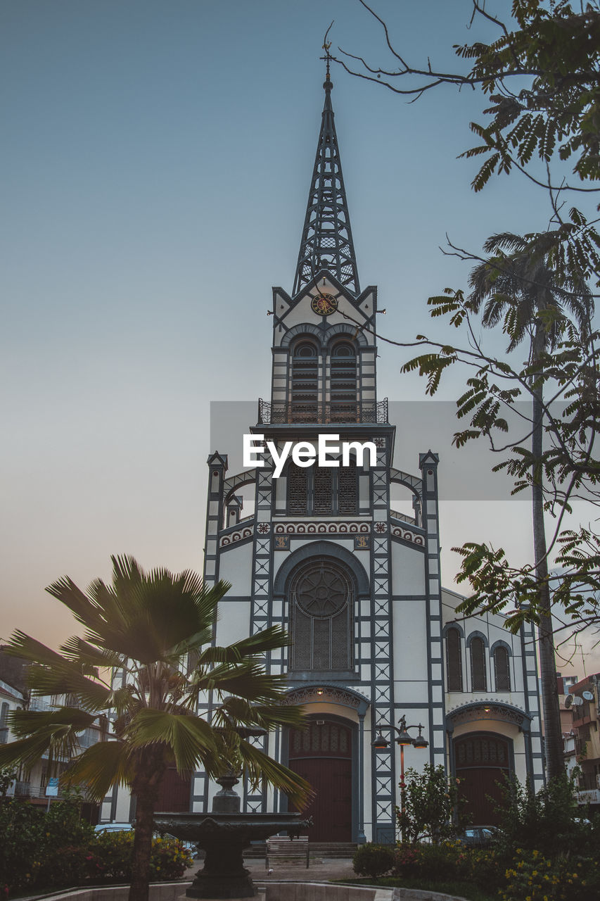 architecture, built structure, building exterior, building, plant, tree, sky, religion, belief, place of worship, nature, spirituality, palm tree, low angle view, tropical climate, tower, no people, outdoors, spire, location, place