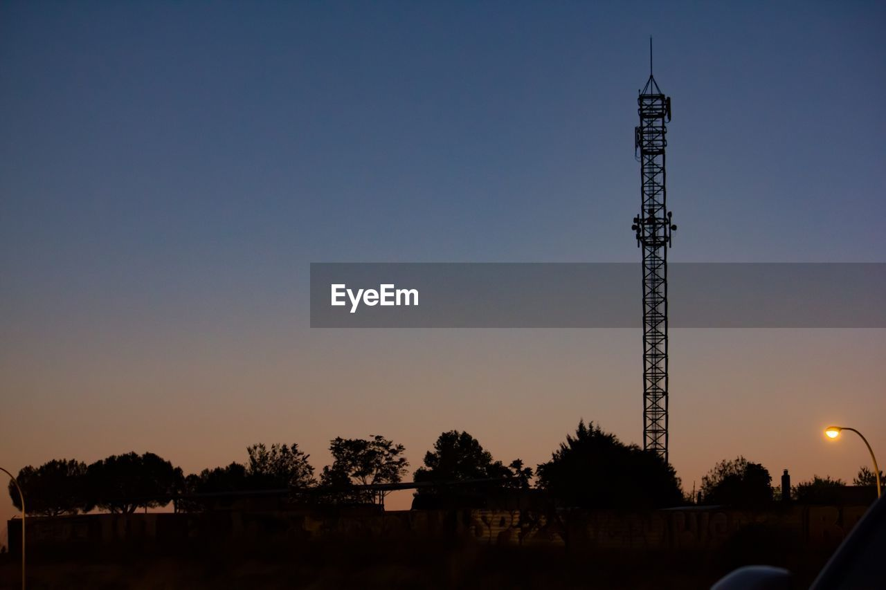 sky, sunset, built structure, tree, architecture, nature, copy space, tower, silhouette, technology, connection, clear sky, plant, no people, communication, outdoors, orange color, dusk, beauty in nature