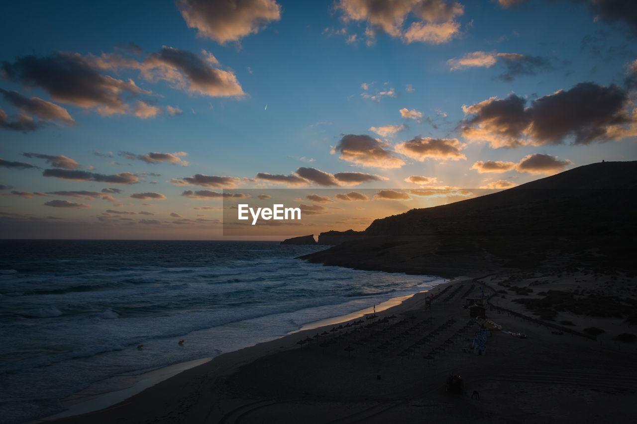 sky, sea, sunset, water, beauty in nature, land, beach, scenics - nature, cloud - sky, horizon, horizon over water, tranquil scene, tranquility, sand, nature, non-urban scene, idyllic, motion, outdoors