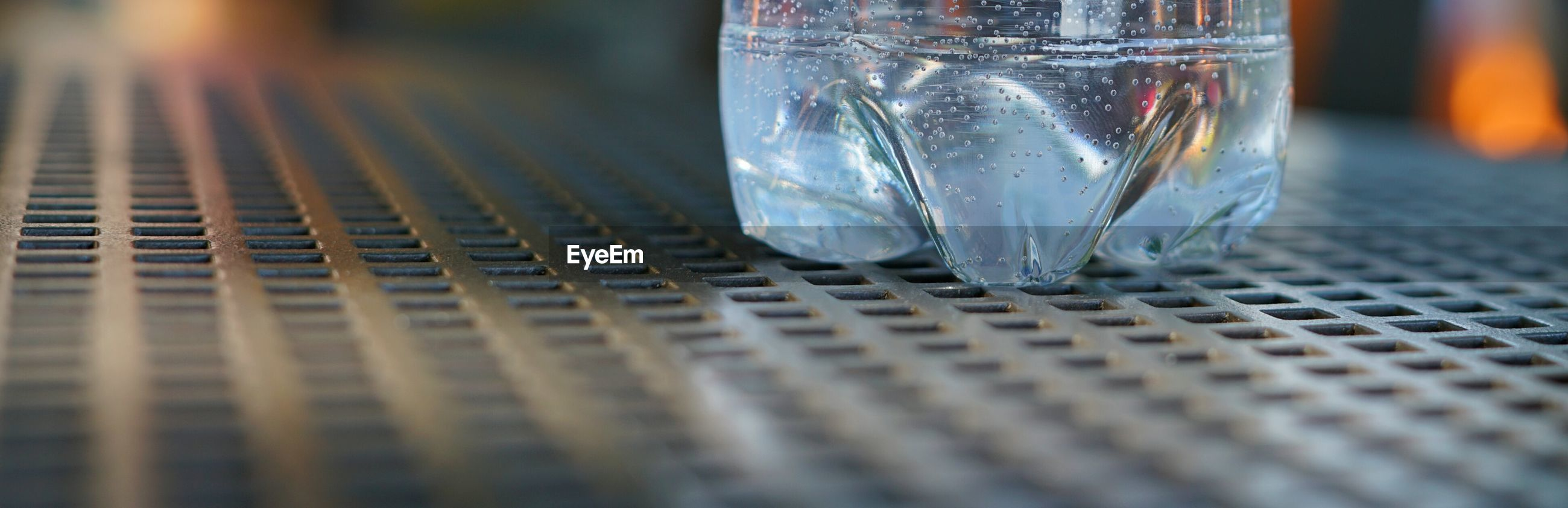 Panoramic view of water bottle on metallic table