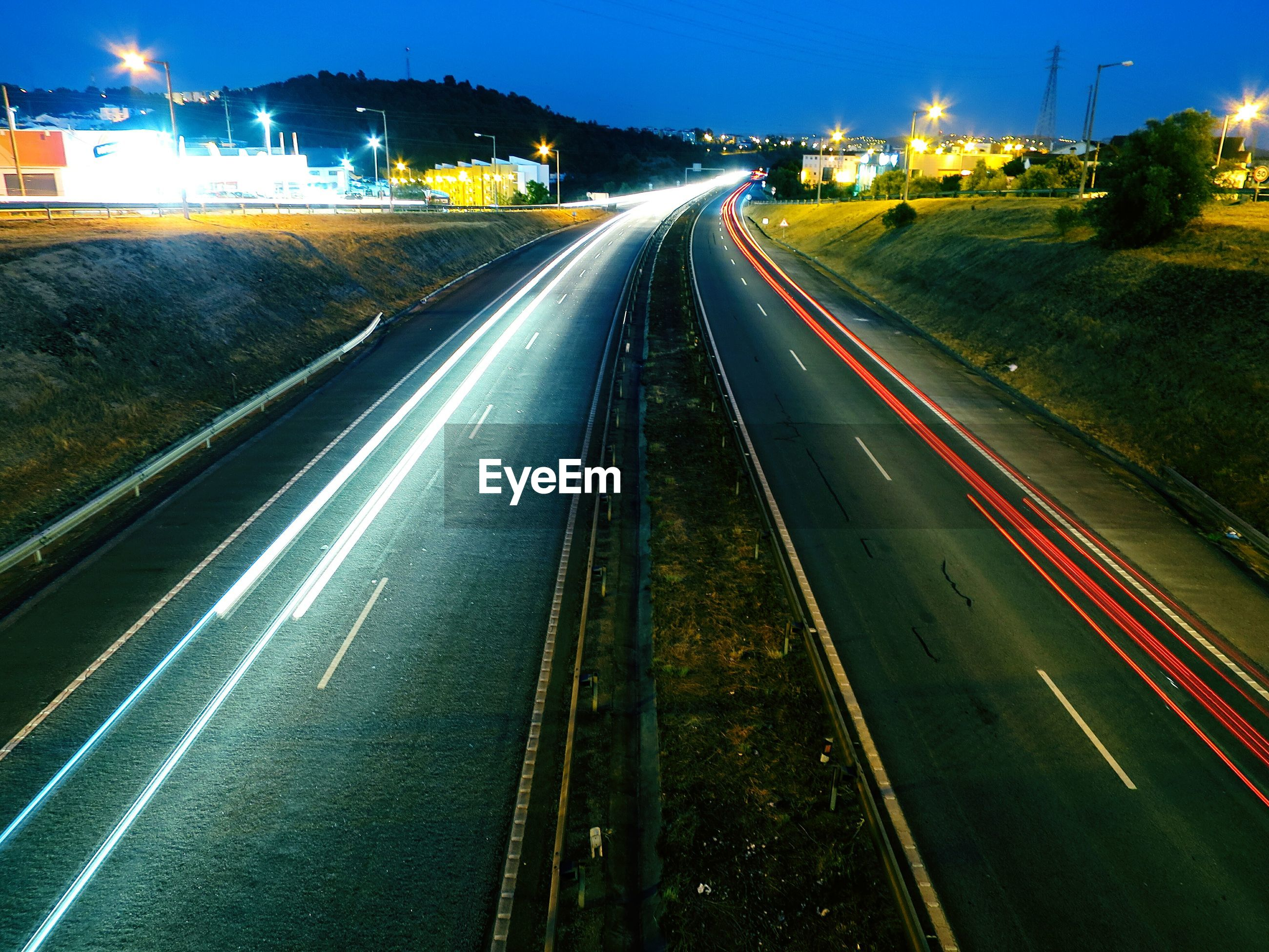 High angle view of light trails on road during dusk