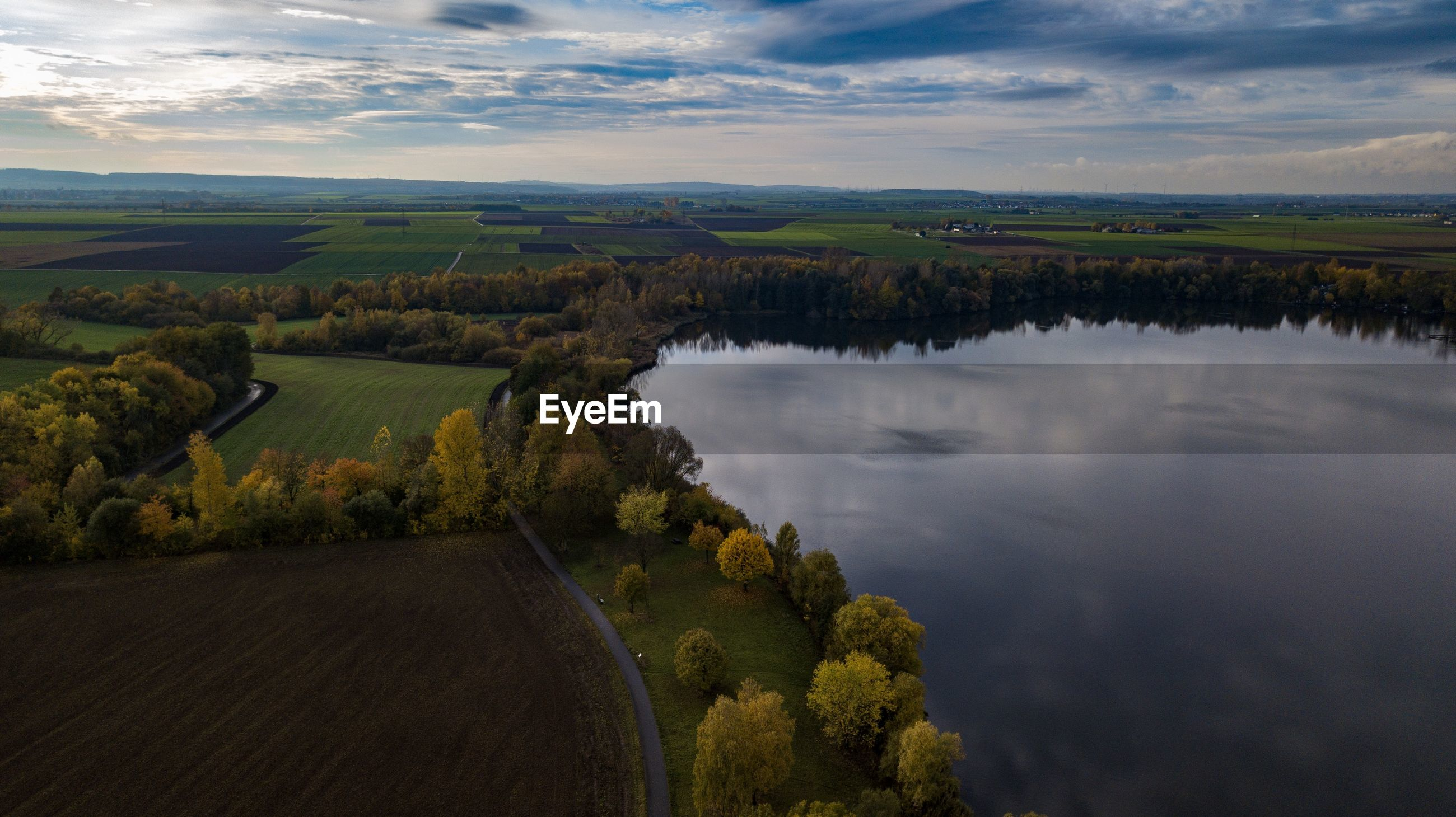 Scenic aerial shot of lake against sky