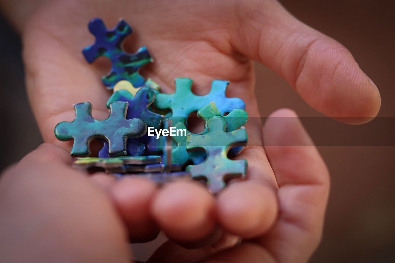 Handsfull Pieces Relationship Hands Puzzle  Human Hand Human Body Part One Person Holding Close-up Human Finger Body Part Toy Connection
